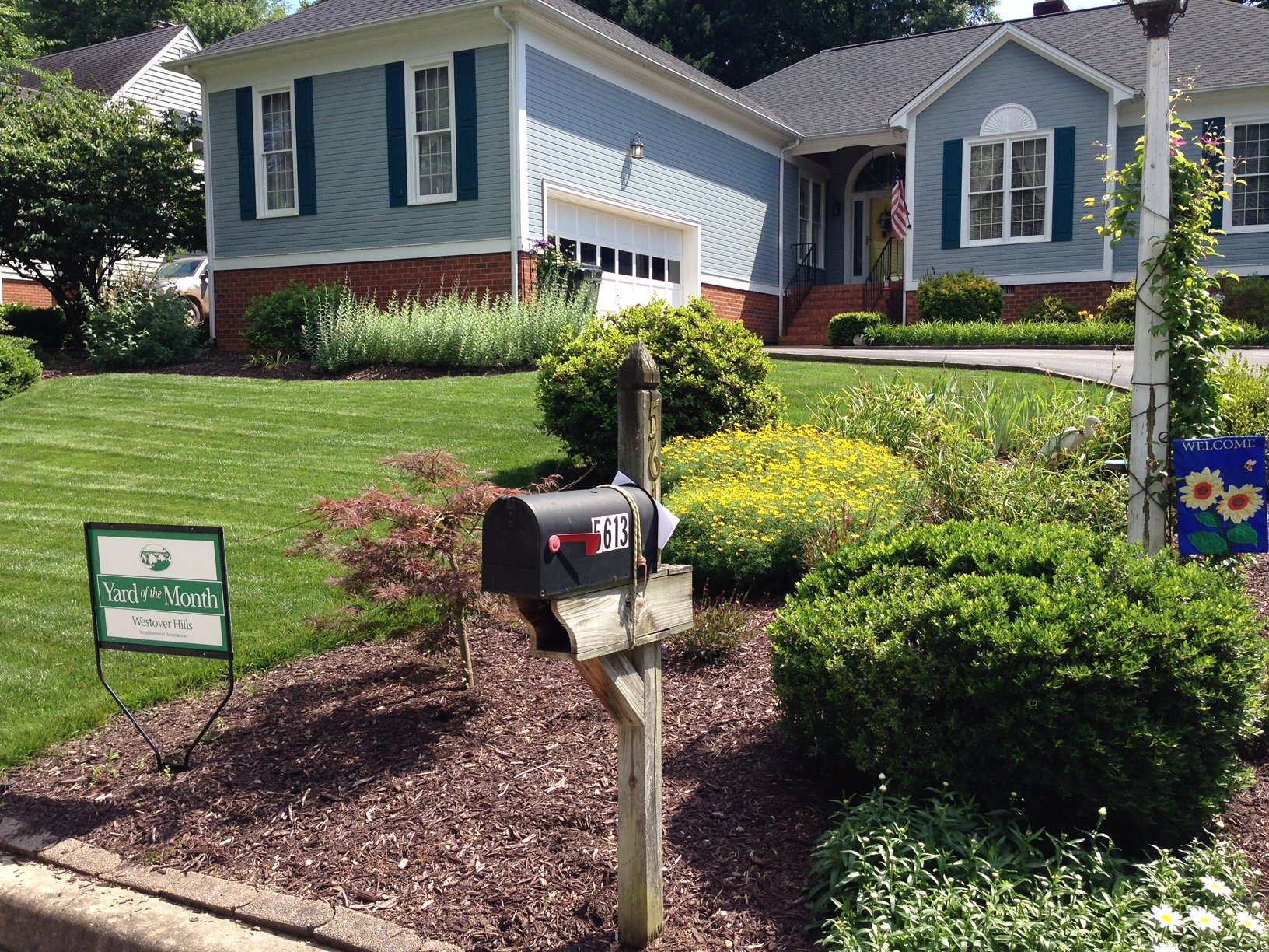 In June, The Grass At This Westover Hills West Home Was Lush And Green And  The Border At The Mail Box Was Beautiful, With Yellow Coreopsis, Shasta  Daisies, ...